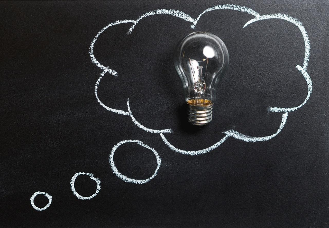 Podium Critical Reasoning - light bulb drawn on blackboard
