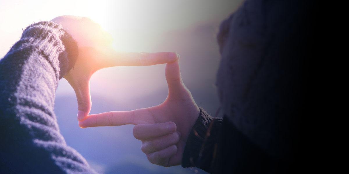 Podium Future Selves - Person looking through fingers